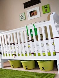 Under the crib is a great place to squeeze in extra storage, or even to store away the next size up or down of baby clothes.