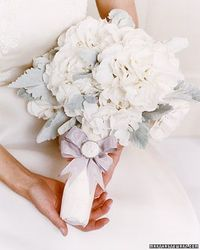 Let these clean, white bridal bouquets represent a fresh new start in your life. We've found examples of timeless, classic arrangements and more unique, inventi