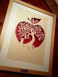 A large papercut, hand drawn and hand cut from a single sheet of paper using a scalpel. The paper is hammered cream and the cut floats over a red background casting beautiful shadows.Framed in a large, luxury beech wood box frame, double mounted and signe...