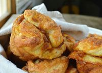 Pumpkin Pull Apart Bread Muffins Recipe: refrigerated biscuit dough, canned pumpkin purée, sugar, butter, cinnamon, nutmeg, cloves and sugar. Bake at 375° for 15-17 minutes.