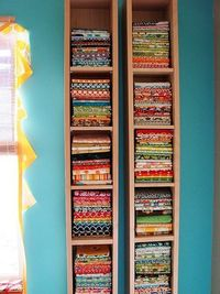 CD/DVD shelves as fabric storage. This is a really neat idea. If I ever have a real craft room with my sewing machine set up, I am doing this!