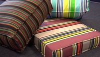 Need some new outdoor cushion covers but can't find what you want for the price? DIY cushion covers are awesome, because they cost a fraction of what it would t