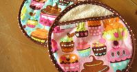 Circular Pot Holders with Cupcakes on a Turquoise Blue and Pink Background - Set of 2 Michael Miller Sweet Treats