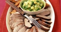This lean pork tenderloin gains lots of flavor from its spice rub and its side of Avocado-Pineapple Salsa.