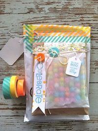 layered glassine bags with washi tape, buttons, twine