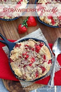 A sweet and simple cake topped with fresh strawberries and streusel.