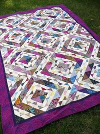 "This quilt started from an exchange of ""ugly fabric"" strips (2.5 and 4.5 inches). The challenge was that we could not eliminate any fabrics when making the quil"