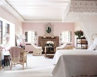 """The pale pink Marrakech bedroom of Marella Agnelli combines Morrocan architectural details with Agnelli's famed wicker chairs and hand-crocheted bed hangings�€""""a space truly befitting a swan."""