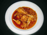 Easy chicken curry recipe is made using cooker. Bone in chicken pieces are simmered in a rich tomato onion gravy with some spices till done.
