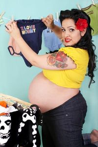 A pin-up and pregnant Rosie the Riveter-inspired maternity session | Offbeat Families