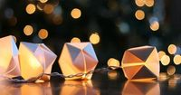 Paper Lantern Light String. How to: http://www.re-nest.com/re-nest/diy/diy-origami-paper-cube-string-lights-wit-whistle-161985