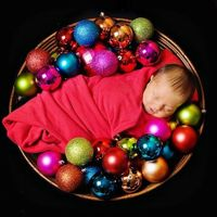 This newborn photo is adorable!! Baby's first Christmas,