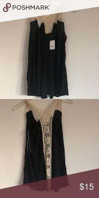 Xs Black tank top with back cut outs NWT! Bought too many!! Rue21 Tops Tank Tops
