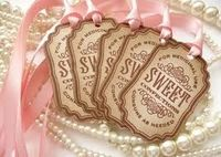 Great tages and idea for adding vintage flare to the candy buffet bags!