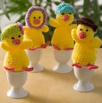 Crochet a set of four chick egg cozies, a full family each complete with a different hat, to adorn your spring table. These cute crochet chicks would be perfect