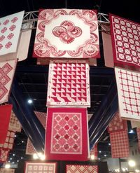 These were some of the quilts displayed at Quilt Market in Houston, Texas. #RedAndWhite
