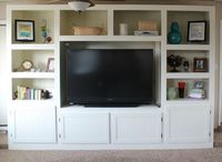 My hubby just built our version of this and I LOVE it!!! DIY entertainment center