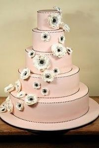 Five tier pale pink wedding cake with anemone flowers