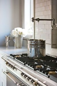 Pot filler faucet over stove...this has way too much money...I envy them lol