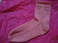 Celebrate Valentine's Day with these Ruffled Heart Socks. Make them as gifts for your friends or yourself. This easy sock pattern let's you pick multiple cuff o