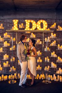 marquee letters and illuminated candles, photo by Amanda Watson, styling by Emerson Events http://ruffledblog.com/mixed-metals-summer-wedding-inspiration #weddingideas
