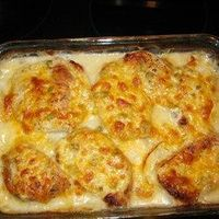 """Pork Chop and Potato Casserole   """"My family loves this recipe. It is easy and delicious. Pork chops are browned, then baked in a creamy mushroom sauce with potatoes, onion and cheese."""""""