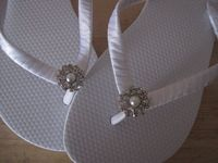 Wrap satin ribbon around flip flops and add embellishment.