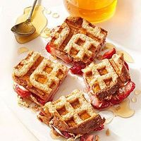 Looking for a unique waffle maker recipe for breakfast? Try our Strawberries and Cream Cheese Waffle Sandwiches. This fun waffle sandwich combines softened crea