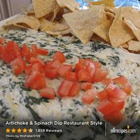 "Artichoke & Spinach Dip Restaurant Style | ""I couldn't walk away! My husband and I almost went through an entire bag of chips with this because we couldn't stop! Excellent recipe!!"" -SKJacobson"