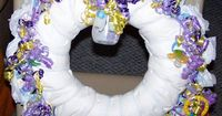 How to Make a Diaper Wreath. A beautiful diaper wreath is a unique, easy to make gift that can serve as a decoration until it's used by the mom-to-be. It requir