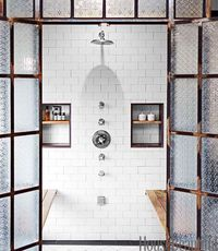 A fresh look in an old Spanish Revival bath.