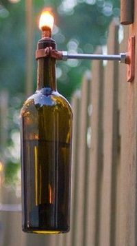 Wine Bottle Tiki Torch I've made a bunch of these with old bottles but never thought to hang them this way! I usually put mine in a flower pot and fill the pot with colored glass or shells.