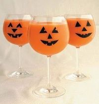 """Jack-O'-Lantern wine glasses from the book """"Halloween Tricks and Treats"""" by Matthew Mead (black tape to make the faces and then filled a pitcher with ice, add ½ cup vodka, ½ cup orange liqueur (such as Triple Sec), 1 cup carrot j..."""