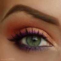 Purple eye liner with peachy pink and gold. almost did this today but wasn't sure of the color combo. will do it next time i'm wearing purple. :)