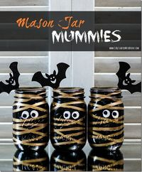 Halloween craft idea with mason jars: Mummy Mason Jars. Includes detailed instructions with pictures of how to make your own centerpiece for Halloween party.
