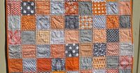 Handmade unisex baby quilt in grey and by bluesquarequilting