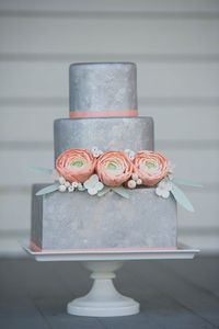 Three tiers, covered in fondant, airbrushed silver, and then dabbed, painted, and flicked with various shades of metalic luster dust. Also features sugar ranunculus, leaves, berries. Photo by Brooke Allison Photo.