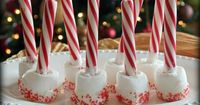 Simple and adorable HOT CHOCOLATE STIRRERS: Use melted white choclate to add the sprinkles and candy canes