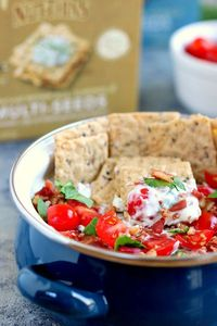 Loaded with the classic toppings of bacon, lettuce, and tomato, this Skinny BLT Ranch Dip is made with a Greek yogurt base and swirled with hints of ranch dressing.