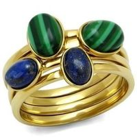 A stunning tiered gold effect band contrasts with green and blue stones