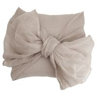 Linen and cotton-blend throw pillow with oversized bow accent.Product: Pillow Construction Material: Linen and...