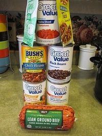 Taco Soup - Brown meat (you can use any ground beef or turkey, put in crock pot with cans of crushed tomatoes, black beans, pinto beans in chili sauce, rotel, and corn. -add packets of each, ranch powder mix and taco seasonings, and the other seasonin...