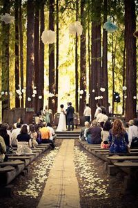 I would love to have a forest wedding, with the trees surrounding us and the sun coming through the leaves.