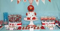 This spectacular Elmo party for one tiny Elmo love comes from a very fabulous client of mine, Cecelia all the way from down under. She had a vision for her Elmo