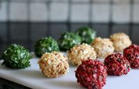 Goats cheese truffles. Take goats cheese, season with pepper and shaped into small balls - roll in chopped chives, pink peppercorns or chopped nuts - perfect canopes by Lorraine Pascale Everday cooking.