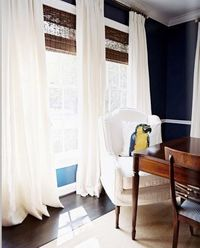 Navy walls, white curtains, bamboo blinds, white bedding. Maybe gray upholstered bed.
