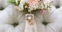 Wedding bouquet with lace and brooch