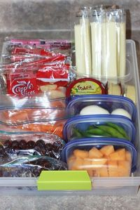 Super idea! Create a healthy snack drawer for the fridge. Toss in pre-packed snacks to go for the whole week. So smart!!!
