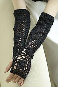 Opera Sleeves Crochet fingerless gloves. This pattern is published by Lion Brand Yarns, and is available for download