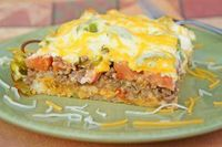 One of our most popular recipes EVER -- John Wayne Layered Casserole! Meaty, cheesy and filled with tons of delicious ingredients. What more do you need to know? Get the easy casserole recipe right here...